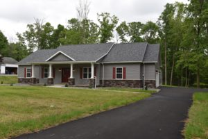 custom built home, granite countertop X shingled roof X roofing X built in cook top X built in fridge X custom backsplash X custom bathroom sink X custom cabinetry X custom kitchen X Drip Edge X Fascia X full remodel X Garage Door X hard wood flooring X hardwood floors X kitchen X new sink X new toilet X Northwestern Pennsylvania X Siding X foundation X full basement X drip edge X custom built fireplace X custom tile shower X walk in shower X glass paneled shower X driveway X blacktop driveway X landscape X interior X exterior X new home X design X plush carpet X vanity X closet