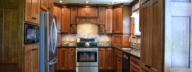 Quartersawn Custom Oak Cabinets, Under Cabinet Lighting, Custon Tile Backsplash, Uba Tuba Granite Countertops, Undermount Sink, Grouted Tile Flooring.